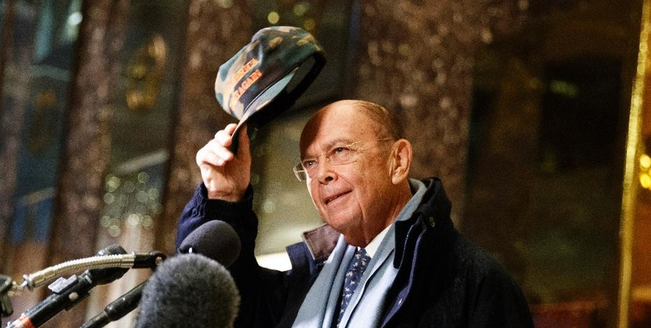 Billionaire investor Wilbur Ross talks with reporters in the lobby of Trump Tower, Tuesday, Nov. 29, 2016, in New York. (AP Photo/Evan Vucci)