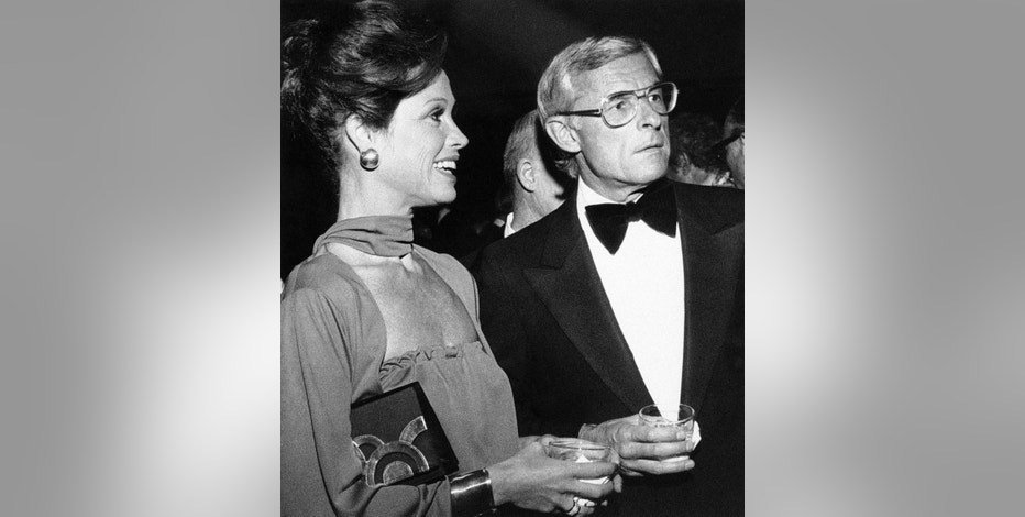 "FILE - In this Nov. 7, 1976, file photo, Mary Tyler Moore attends a reception in Los Angeles with her husband, Grant Tinker, before she was honored by the Hollywood chapter of the National Academy of Television Arts and Sciences for outstanding achievement in the industry. Tinker, who brought ""The Mary Tyler Moore Show"" and other hits to the screen as a producer and a network boss, has died. Tinker died Monday, Nov. 28, 2016, at his home in Los Angeles, according to his son, Mark Tinker. (AP Photo/File)"