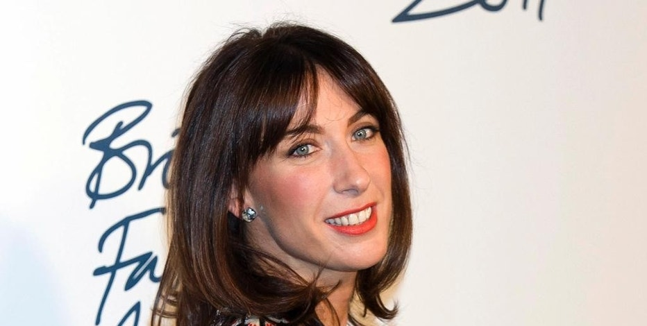 FILE  - In this Monday, Nov. 28, 2011 file photo, Samantha Cameron arrives for the British Fashion Awards 2011 at a central London venue. Cameron, the wife of former British Prime Minister David Cameron, is launching her first fashion label. Cameron, an ambassador for the British Fashion Council, has long been involved in the fashion industry.  (AP Photo/Jonathan Short, File)
