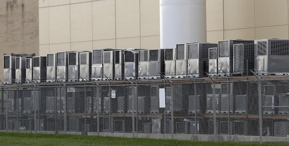 Air conditioning units are stacked outside the Carrier Corp. plant, Wednesday, Nov. 30, 2016, in Indianapolis. Carrier and President-elect Donald Trump reached an agreement to keep nearly 1,000 jobs in Indiana. Trump and Vice President-elect Mike Pence planned to travel to the state Thursday to unveil the agreement alongside company officials. (AP Photo/Darron Cummings)