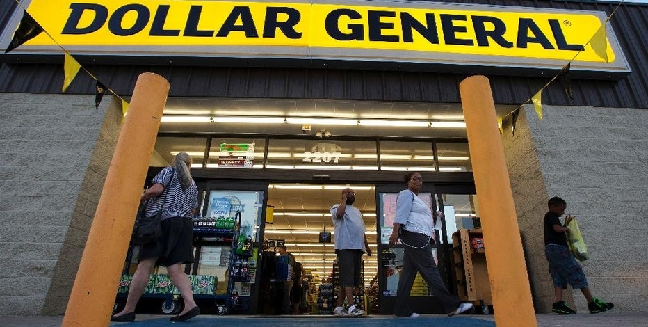 FILE - In this Wednesday, Sept. 25, 2013, file photo, customers exit a Dollar General store in San Antonio. Dollar General Corporation reports financial results, Thursday, Dec. 1, 2016. (AP Photo/Eric Gay, File)