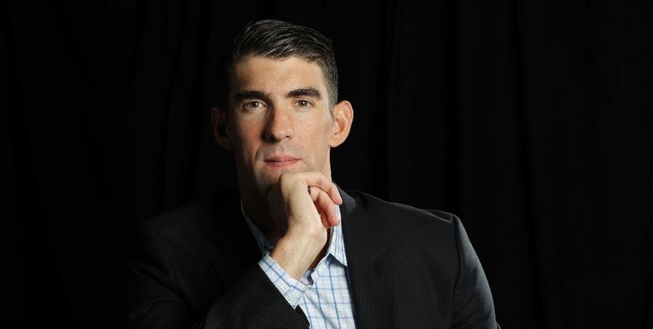 In this Tuesday, Oct. 25, 2016, photo, former Olympic swimmer Michael Phelps poses for a portrait while attending the Quickbooks Connect conference as a featured speaker in San Jose, Calif. Phelps is looking for his next golden opportunity in business after retiring from his sport as the most decorated athlete in Olympic history. He thinks he might find it in Silicon Valley, joining a growing list of athletes and entertainers trying to build upon their fortunes in a technology-driven area teeming with geeky millionaires. (AP Photo/Marcio Jose Sanchez)