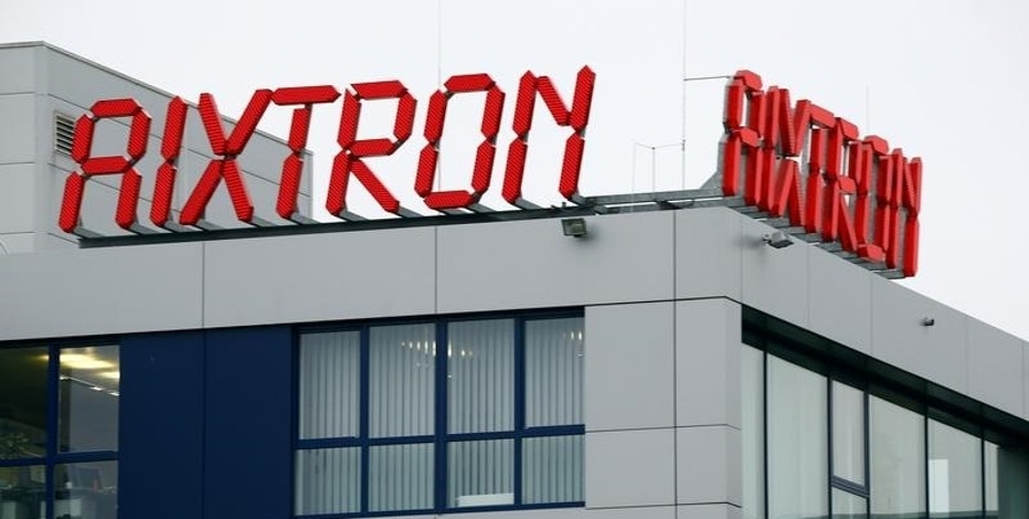 The logo of Aixtron SE is pictured on the roof of the German chip equipment maker's headquarters in Herzogenrath near the western German city of Aachen, October 25, 2016. REUTERS/Wolfgang Rattay/Files