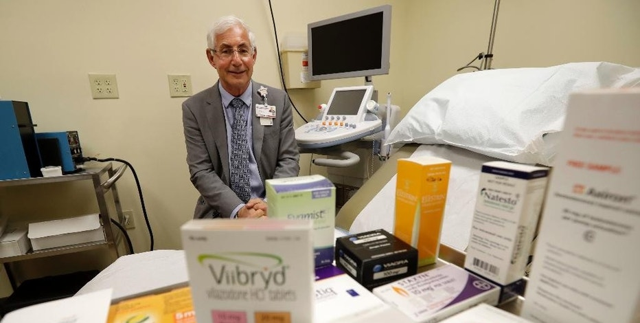 "In this Tuesday, Nov. 29, 2016 photo, Dr. Irwin Goldstein poses in his office in San Diego behind a display of medicine for impotence and for sexual problems. For couples who can't afford the soaring prices for the prescriptions, some take a big risk, buying ""herbal Viagra"" at gas stations or ordering Viagra online from ""Canadian pharmacies"" that likely sell counterfeit drugs made in poor countries, says Goldstein, director of San Diego Sexual Medicine. (AP Photo/Gregory Bull)"