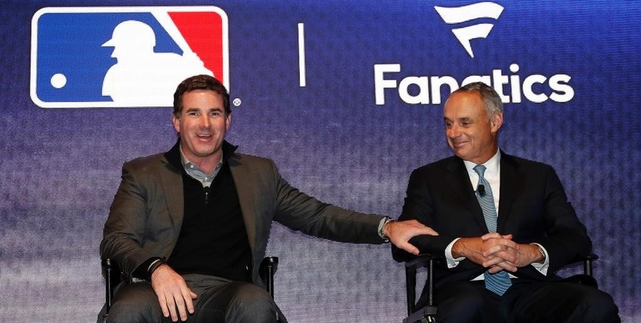 Under Armour Chief Executive Officer and founder Kevin Plank, left, speaks on stage with Major League Baseball commissioner Rob Manfred during an Under Armour announcement event at Major League Baseball's winter meetings, Monday, Dec. 5, 2016 in Oxon Hill, Md. Under Armour will take over as the supplier of Major League Baseball uniforms in 2020. (AP Photo/Alex Brandon)