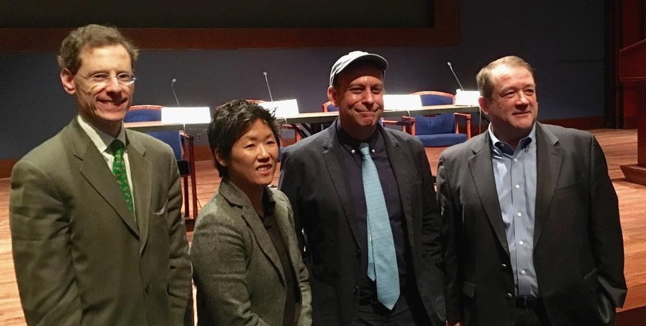 From left, Mark Lagon, Centennial Fellow and Distinguished Senior Scholar at the Walsh School of Foreign Service, Georgetown University; Kathryn Xian, Executive Director of the Pacific Alliance to Stop Slavery; moderator Paul Greenberg and National Fisheries Institute President John Connelly pose on Capitol Hill in Washington, Tuesday, Dec. 6, 2016, during a forum to improve conditions for hundreds of foreign fishermen working in Hawaii's commercial fleet, Wednesday, Dec. 6, 2016, on Capitol Hill in Washington. (AP Photo/Matthew Daley)