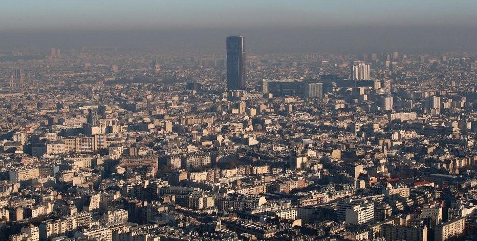 The Montparnasse Tower is seen from a hot air balloon as Paris suffers a pollution spike, Monday Dec. 5, 2016. Paris authorities have adopted measures to limit traffic speed after high levels of pollution in the French capital. (AP Photo/Christophe Ena)