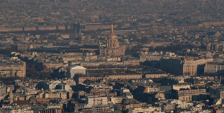 The Invalides dome is seen from a hot air balloon as Paris suffers a pollution spike, Monday Dec. 5, 2016. Paris authorities have adopted measures to limit traffic speed after high levels of pollution in the French capital. (AP Photo/Christophe Ena)