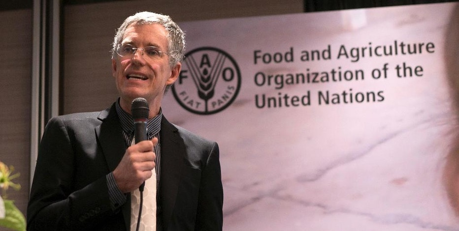 David Dawe, Senior Economist, FAO Regional Office for Asia and the Pacific addresses a conference in Bangkok, Thailand, Tuesday, Dec. 6, 2016. Asia has halved hunger rates in the past quarter century, but because of westernized lifestyles, obesity is skyrocketing and people aren't getting enough vitamins and minerals, according to a new UN report.(AP Photo/Dake Kang)
