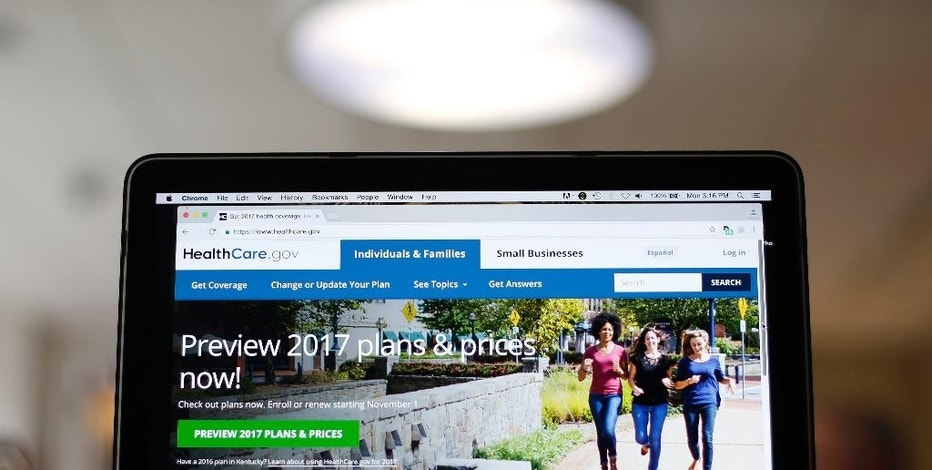 FILE - This Oct. 24, 2016, file photo, shows the HealthCare.gov 2017 website home page on display, in Washington. Health insurance experts say the decision to buy 2017 coverage on the Affordable Care Act's public exchanges shouldn't boil down to a gamble over the survival of the law, which requires most people to have insurance. Instead, customers should focus on whether they can handle the financial risk that comes with remaining uninsured while they wait for Trump's health care plan to crystallize. (AP Photo/Pablo Martinez Monsivais, File)