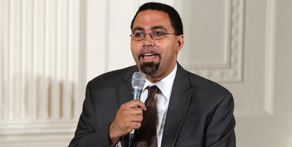 FILE - In this July 19, 2016, file photo, Education Secretary John B. King, Jr., speaks on a panel with first lady Michelle Obama to college-bound students participating in the Reach Higher initiative's third annual Beating the Odds event in the East Room of the White House in Washington.King has upheld his department's decision to cut ties with the nation's largest accreditor of for-profit colleges. The Accrediting Council for Independent Colleges and Schools was appealing a previous decision to revoke its oversight of hundreds of for-profit colleges. The U.S. Department of Education made that decision in September after the council was accused of lax oversight. (AP Photo/Jacquelyn Martin, File)