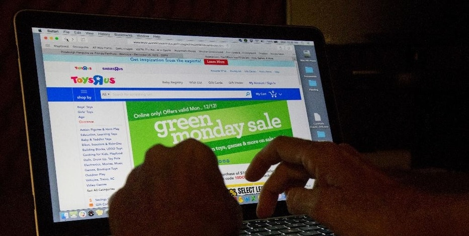 "An online shopper searches different sites, Monday, Dec. 12, 2016, from Miami. Unfortunately, there's no time like the holidays for fraud. Online shopping is convenient and popular, for shoppers and scammers alike. Experts suggest restricting your purchases to reputable vendors, and be wary of lookalike websites, where the name of a well-known brand is slightly off. Also, don't click on emails and links from unfamiliar senders, and make payments only on secure sites indicated by a lock symbol or ""https"" in the web address. (AP Photo/Wilfredo Lee)"