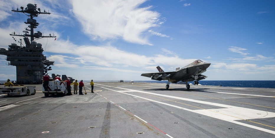 An F-35C Lightning II carrier variant, assigned to the Salty Dogs of Air Test and Evaluation Squadron (VX) 23, performs a touch-and-go on the flight deck of the aircraft carrier USS George Washington (CVN 73). VX-23 is conducting its third and final developmental test (DT-III) phase aboard George Washington in the Atlantic Ocean. The F-35C is expected to be Fleet operational in 2018.