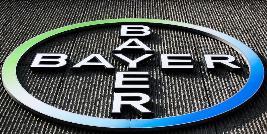 FILE - This Monday, May 23, 2016, file photo, shows the Bayer AG corporate logo displayed on a building of the German drug and chemicals company in Berlin. On Tuesday, Dec. 13, 2016, Monsanto Co. shareholders approved a $57 billion merger with Bayer AG, a deal that would combine two of the world's biggest agricultural companies. (AP Photo/Markus Schreiber, File)