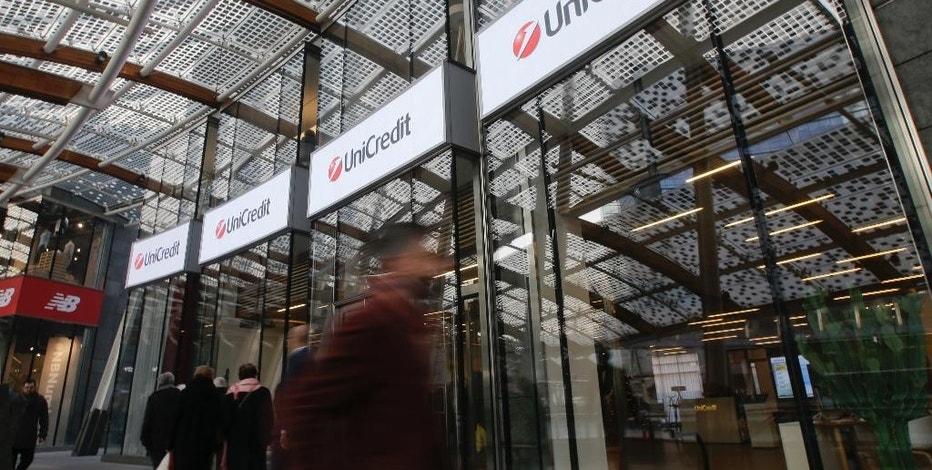 An view of the entrance of theUniCredit tower at the Porta Nuova business district in Milan, Italy, Tuesday, Dec. 13, 2016. Italy's largest bank, UniCredit, said Tuesday it will unload 17.7 billion euros ($18.8 billion) in soured loans, raise billions in new money and shed thousands of jobs as it seeks to re-launch the company under new management. (AP Photo/Luca Bruno)