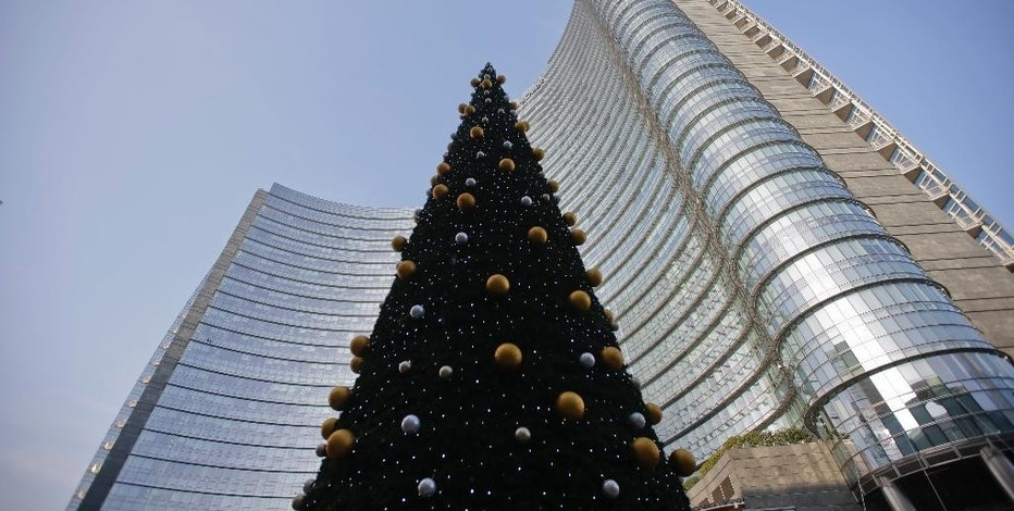 An external view of the UniCredit tower at the Porta Nuova business district in Milan, Italy, Tuesday,Dec. 13, 2016. Italy's largest bank, UniCredit, said Tuesday it will unload 17.7 billion euros ($18.8 billion) in soured loans, raise billions in new money and shed thousands of jobs as it seeks to re-launch the company under new management. (AP Photo/Luca Bruno)