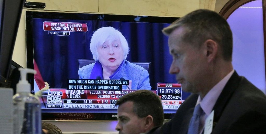 Federal Reserve Chair Janet Yellen's news conference in Washington appears on a screen on the floor of the New York Stock Exchange, Wednesday, Dec. 14, 2016. Stocks slipped Wednesday after the Federal Reserve raised interest rates on the back of a strengthening job market and increased its forecast for rate hikes next year. (AP Photo/Richard Drew)