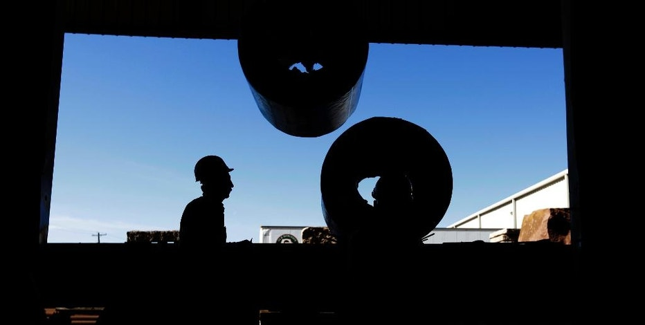 In this Monday, Nov. 21, 2016 photo, workers load rolls of sheet metal at LMS International in Laredo, Texas. Donald Trump's campaign promise to abandon the North American Free Trade Agreement helped win over Rust Belt voters who felt left behind by globalization. But U.S. border cities that have thrived under the trade pact - such as Laredo and El Paso in Texas, and Nogales in Arizona - now worry that an economic reckoning could be coming its way. (AP Photo/Eric Gay)