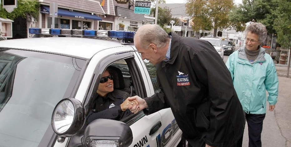 FILE -  In this Oct. 16, 2010 file photo Democratic candidate for the Massachusetts 10th congressional district Bill Keating greets a police office in her cruiser on Commercial Street while campaigning in Provincetown, Mass, as State Rep. Sarah Peake, right, looks on. Keating first introduced a bill in 2012 and tried again in 2013 and 2015 that would require the FDA to gradually replace all opioids with harder-to-abuse versions. (AP Photo/Stephan Savoia, File)
