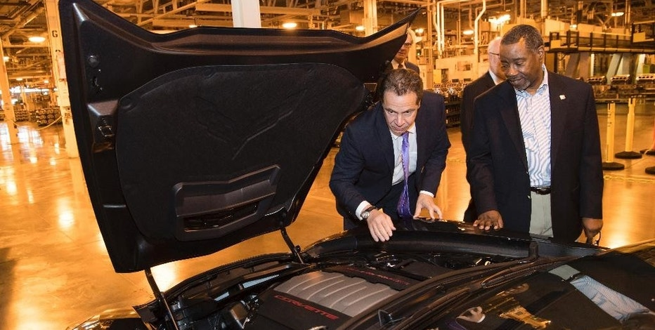 FILE - In this Wednesday, Dec. 14, 2016, file photo provided by the Office of the Governor of New York, Gov. Andrew Cuomo inspects a Corvette engine at the General Motors Tonawanda engine plant in Tonawanda, N.Y. General Motors announced on Wednesday that the company will spend $334 million to upgrade three plants in upstate New York. Manufacturers in New York state expanded more quickly in December, than in November, driven by a big jump in new orders, according to information released Thursday by the Federal Reserve Bank of New York. (Darren McGee/Office of the Governor of New York via AP, File)