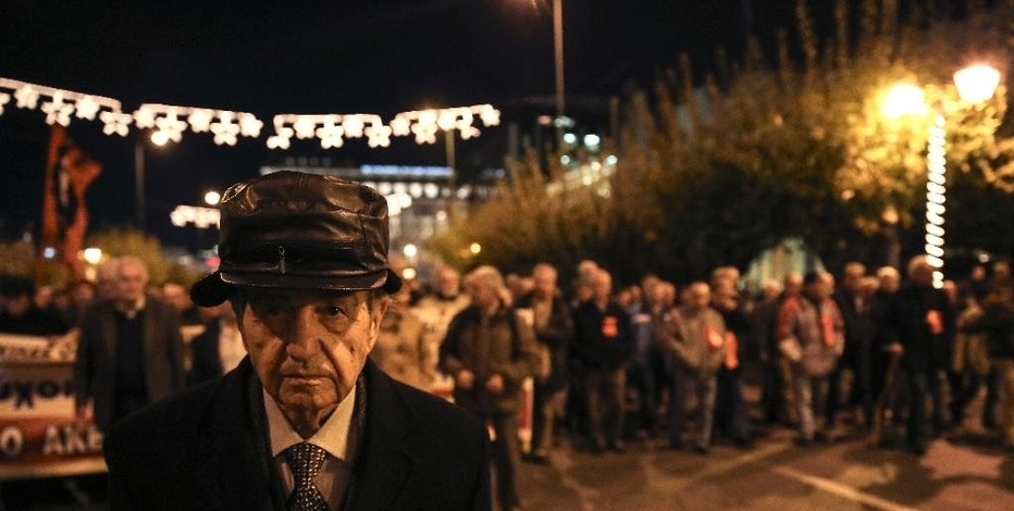 Pensioners march during an anti-austerity rally in Athens, Thursday, Dec. 15, 2016. About 5,000 Greek pensioners marched peacefully through central Athens Thursday to protest years of cuts to their pensions under the country's bailout commitments. (AP Photo/Yorgos Karahalis)