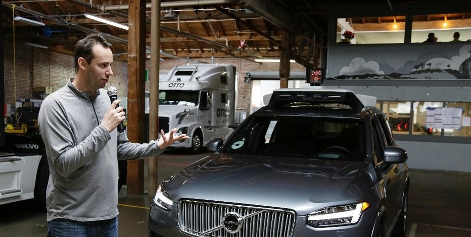 In this photo taken Tuesday, Dec. 13, 2016, Anthony Levandowski, head of Uber's self-driving program, speaks about their driverless car in San Francisco.   The ride-hailing company is refusing to obey demands by the state's Department of Motor Vehicles that it stop picking up San Francisco passengers in specially equipped Volvo SUVs. Hours after Uber launched the self-driving service Wednesday, Dec. 14,  the DMV warned it was illegal because the cars did not have a special permit.  (AP Photo/Eric Risberg)