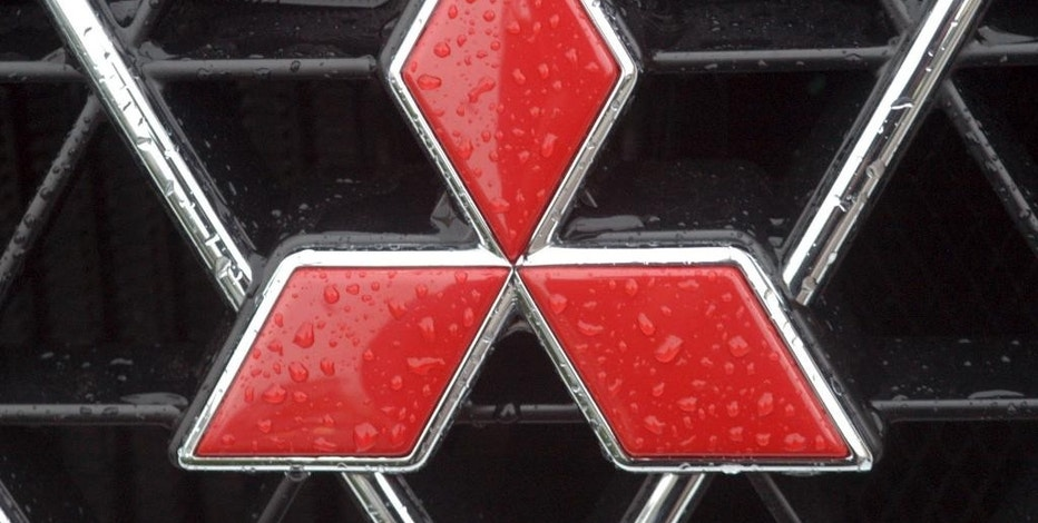 FILE -  This April 23, 2004 file photo shows a Mitsubishi logo in Frankfurt, Germany. Mitsubishi is recalling more than 50,000 Outlander Sport SUVs because the rear hatch lift gate can suddenly fall on people. The company says in documents posted Friday, Dec. 16, 2016  by U.S. safety regulators that the recall covers certain SUVs from the 2011, 2012 and 2016 model years. (AP Photo/Bernd Kammerer)