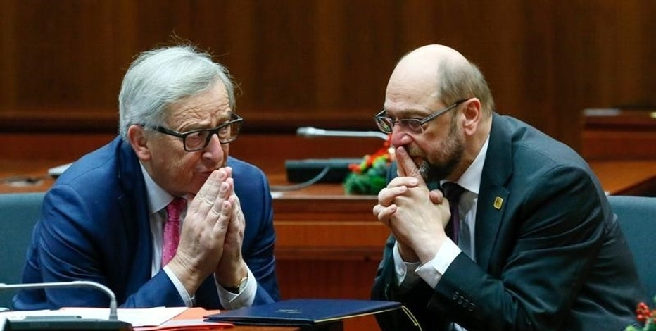 European Commission President Jean Claude Juncker (L) and European Parliament President Martin Schulz attend a EU Summit at the European Council headquarters in Brussels, Belgium December 15, 2016. REUTERS/Yves Herman
