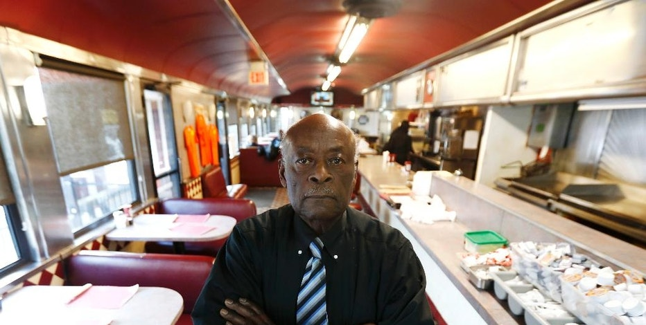 In a photo taken Thursday, Dec. 15, 2016, Russell Graddy poses for a photo in his diner Mr. G's in Paterson, N.J. Graddy said New Jersey Transit owes him more than $1 million after reneging on a promise to let him run a restaurant in Atlantic City's bus terminal and then continued to charge him rent. (AP Photo/Julio Cortez)