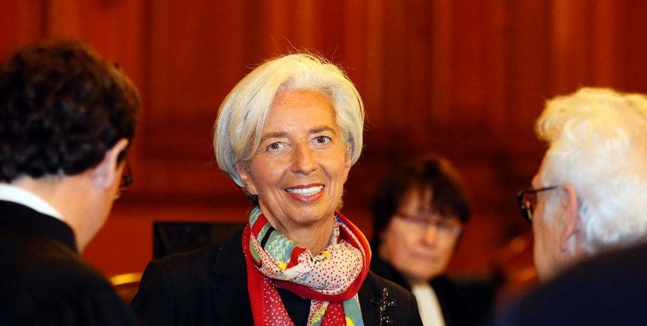 FILE - In this Monday, Dec.12, 2016 file picture, International Monetary Fund chief Christine Lagarde smiles as she arrives at the special Paris court, France. French court finds IMF chief Christine Lagarde guilty in arbitration case, but she escapes punishment. (AP Photo/Francois Mori, File)