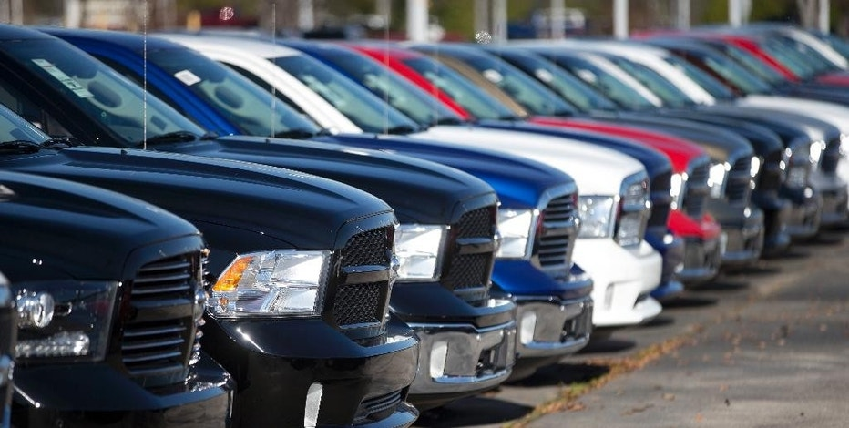 FILE - In this Jan. 5, 2015 file photo, Ram pickup trucks are on display on the lot at Landmark Dodge Chrysler Jeep RAM in Morrow, Ga. The U.S. auto safety agency has opened an investigation into complaints that another 1 million Fiat Chrysler vehicles can roll away after the owners shift transmissions into park, a problem similar to the one being blamed in the death of Star Trek actor Anton Yelchin.  The investigation by the National Highway Traffic Safety Administration covers Fiat Chrysler's top-selling vehicle, the Ram 1500 pickup from the 2013 to 2016 model years, as well as the 2014 to 2016 Dodge Durango.  (AP Photo/John Bazemore, File)