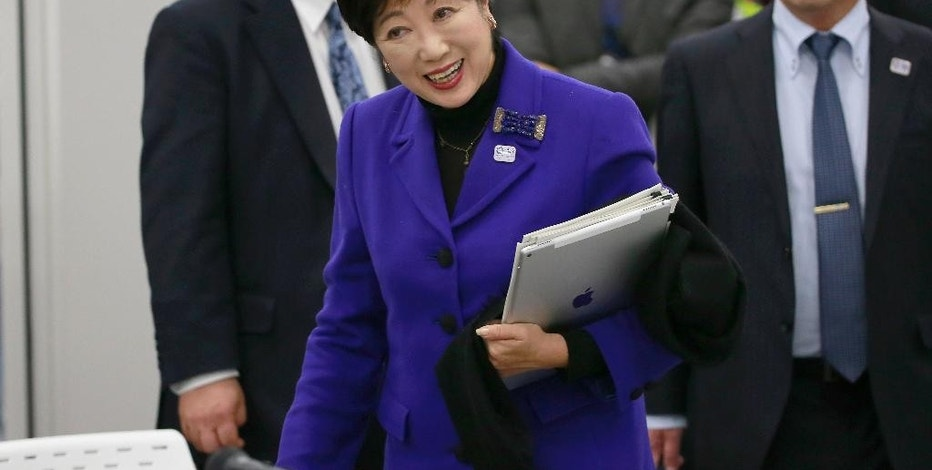 Tokyo Gov. Yuriko Koike arrives at the Four-Party Working Group meeting in Tokyo, Wednesday, Dec. 21, 2016. Japanese Olympic organizers presented their first official cost estimate for the 2020 Tokyo Games at a level slightly below their promised 2 trillion ($17 billion) cap. (AP Photo/Shizuo Kambayashi)