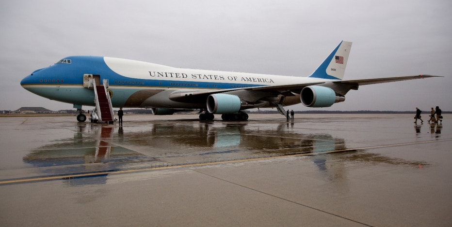 Air Force One is seen on the tarmac at Andrews Air Force Base, Md., Tuesday, Dec. 6, 2016, before President Barack Obama boards en route to MacDill Air Force Base in Tampa, Fla. President-elect Donald Trump wants the government's contract for a new Air Force One canceled.