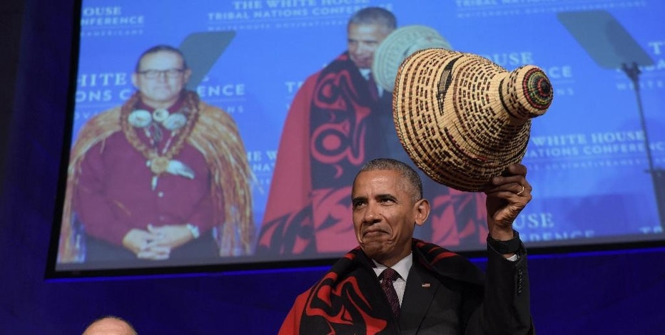 FILE - In this Sept. 26, 2016, file photo, President Barack Obama tips he hat as he stands with Brian Cladoosby, President of National Congress of American Indians, at the 2016 White House Tribal Nations Conference in Washington. The transition to Donald Trump's administration signals a possible end of eight years of sweeping Indian Country policy reforms under Obama, who met with tribal leaders annually. Trump, who rarely acknowledged Native Americans during his campaign, and since the election, hasn't publicly outlined how he would improve or manage the United States' longstanding relationships with tribes. (AP Photo/Susan Walsh, file)