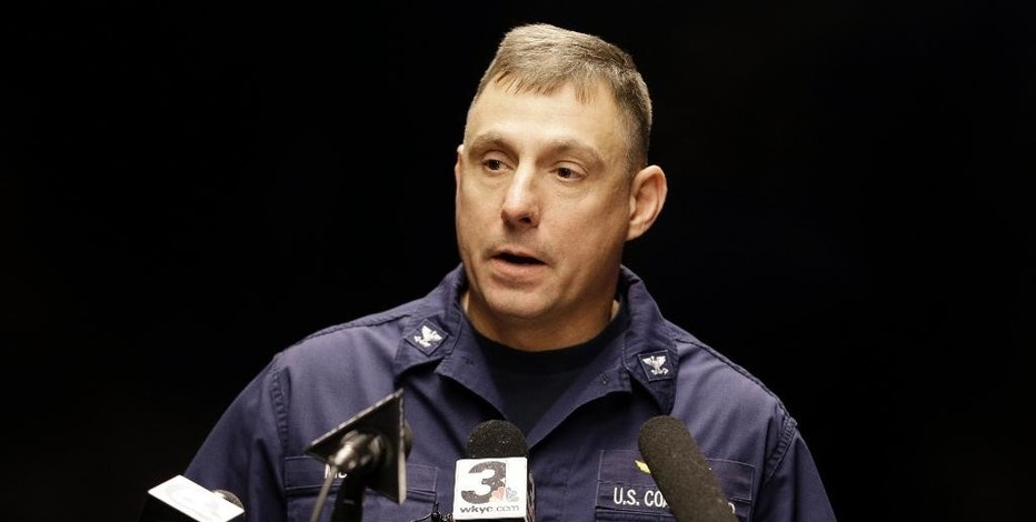 Capt. Michael Mullen of the U.S. Coast Guard answers questions during a news conference at Burke Lakefront Airport, Friday, Dec. 30, 2016, in Cleveland. The U.S. Coast Guard says there's been no sign of debris or those aboard a plane that took off from the airport on the shores of Lake Erie and went missing overnight. (AP Photo/Tony Dejak)