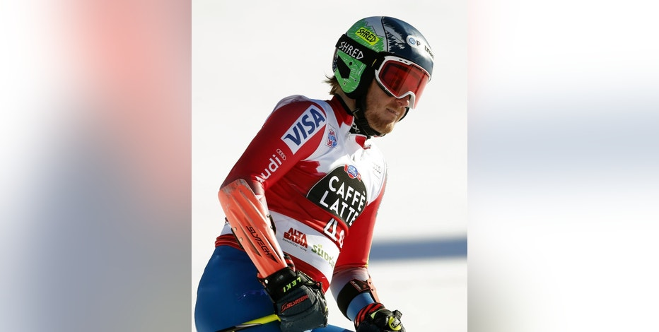 FILE - This is a Sunday, Dec. 20, 2015  file photo of Ted Ligety, of the United States, as he gets to the finish area after completing an alpine ski, men's World Cup giant slalom, in Alta Badia, Italy. Ten years after founding Shred _ the ski helmet, eyewear and accessory company known for its 1980s-style fluorescent colors and designs Ted Ligety has been watching as a proud spectator lately. (AP Photo/Marco Trovati, File)