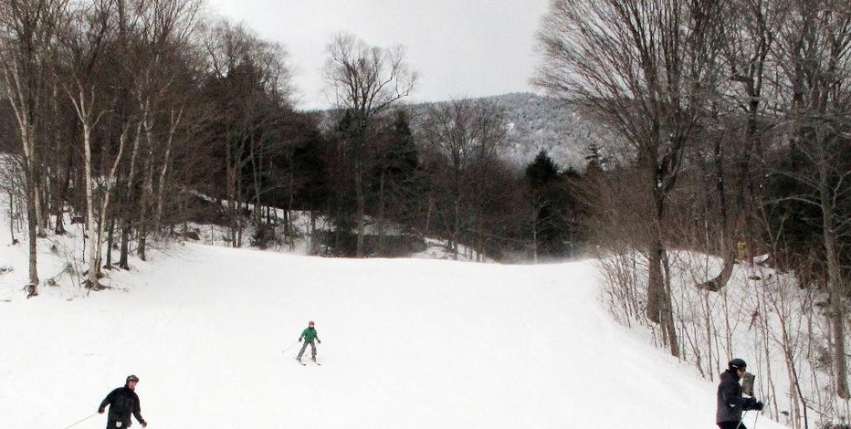 In this Dec. 30, 2016 photo, skiers descend a slope at Mad River Glen in Fayston, Vt. Ski areas are relishing in new snow a day after a powerful storm dumped 20 inches of snow in parts of Maine, and lesser amounts in other areas. Mad River received 6-8 inches. (AP Photo/Lisa Rathke)