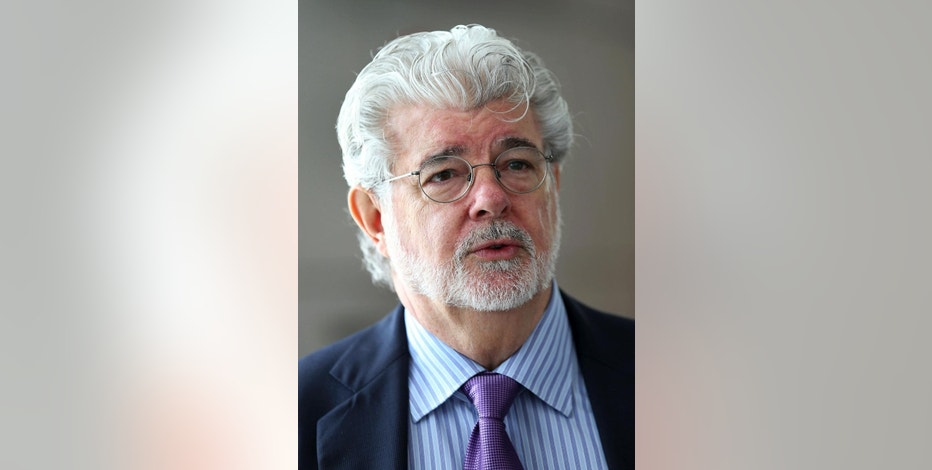In this Jan. 16, 2014, photo George Lucas speaks in Singapore. For nearly a decade Lucas has been trying to build a museum for his extensive personal art collection. In January, the legendary filmmaker is expected to decide whether he will put the museum in San Francisco or Los Angeles, after other attempts were upended by community opposition. (AP Photo/Wong Maye-E, File)