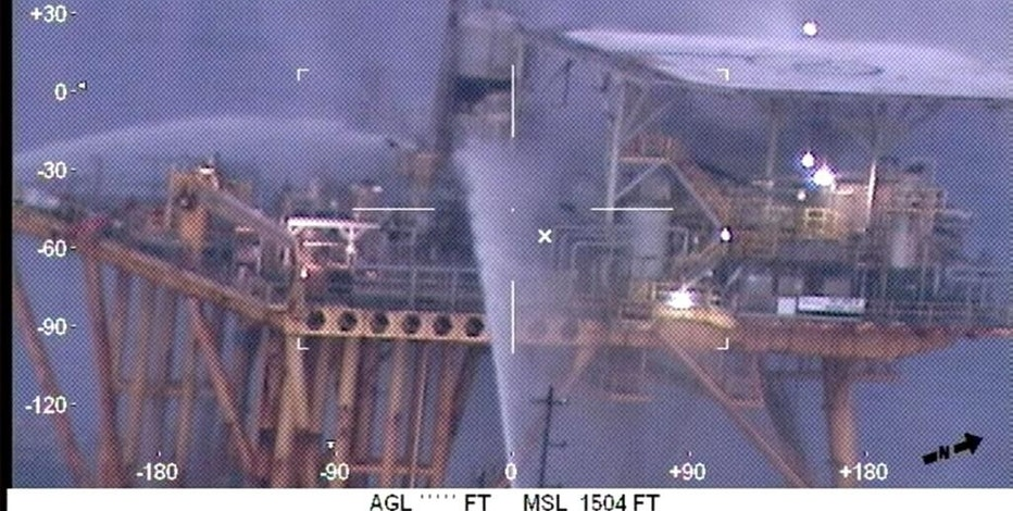 In this image taken from video and released by the U.S. Coast Guard, four offshore supply vessels extinguish a fire on an oil production platform fire 80 miles south off Grand Isle, La., Thursday, Jan. 5, 2016. The pre-dawn fire has been extinguished on an oil production platform in the Gulf of Mexico, and there is no sign of pollution in the area, authorities said Thursday. There were no reports of injuries. (U.S. Coast Guard via AP)
