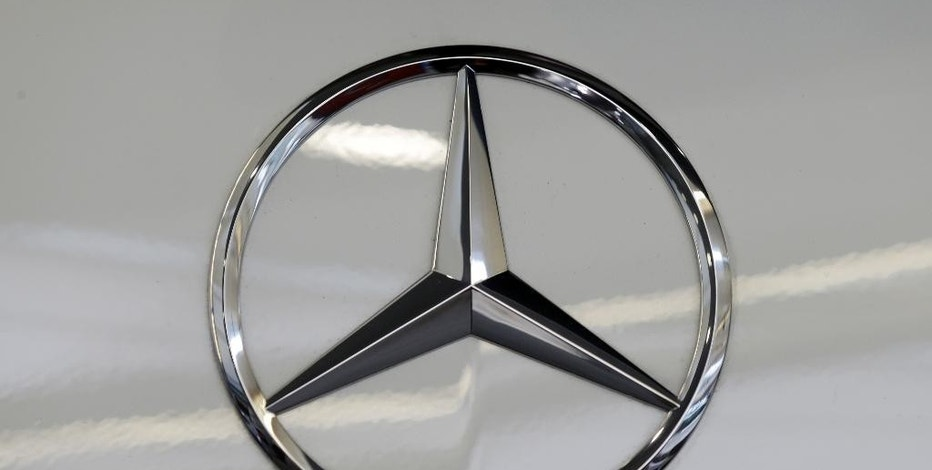 FILE - This Feb. 14, 2013, file photo, shows a Mercedes logo on a Mercedes automobile at the Pittsburgh Auto Show in Pittsburgh. Mercedes-Benz is recalling nearly 48,000 SUVs in the U.S. to fix a sensor problem that could stop the front passenger air bag from inflating in a crash. (AP Photo/Gene J. Puskar, File)