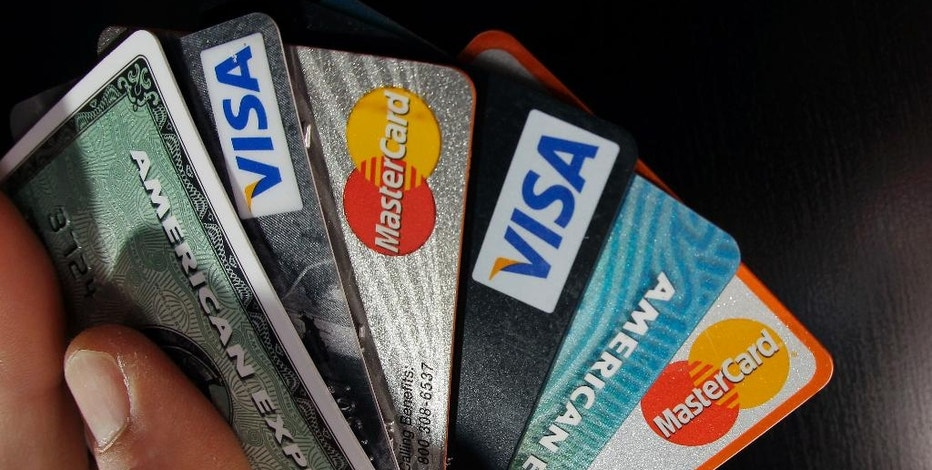 FILE - In this March 5, 2012, file photo, consumer credit cards are posed in North Andover, Mass. Today's competitive credit card market has turned lucrative for consumers, meaning what would have been a good offer just a few years ago no longer measures up. (AP Photo/Elise Amendola, File)