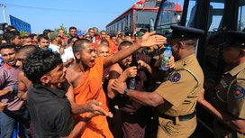Clashes erupt as protesters march against China port deal