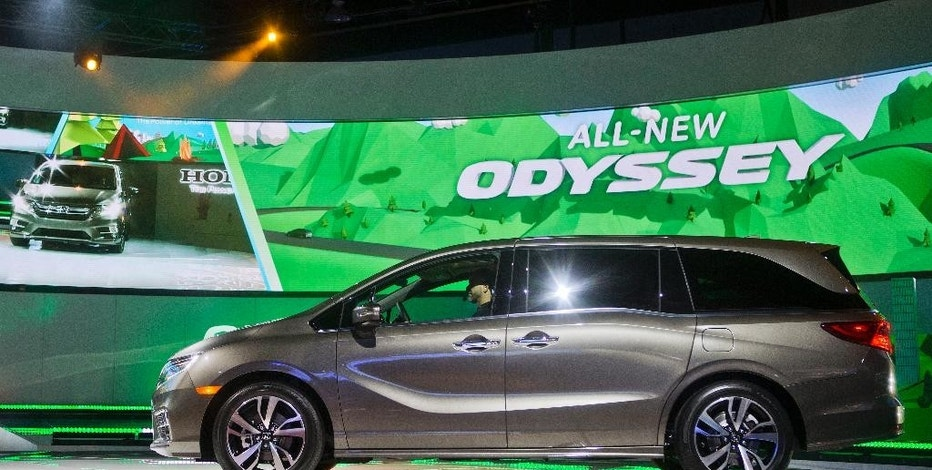 The new Honda Odyssey minivan is unveiled at the North American International Auto Show, Monday, Jan. 9, 2017, in Detroit. (AP Photo/Tony Ding)