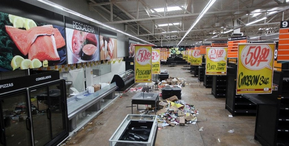 Supermarket displays stand empty and looted following protests caused by a 20 percent hike in gasoline prices, in Veracruz, Mexico, Saturday, Jan. 7, 2017. The Interior Department reported that more than 1,500 people have been detained for looting or disturbances nationwide since protests began early in the week. (AP Photo/Felix Marquez)