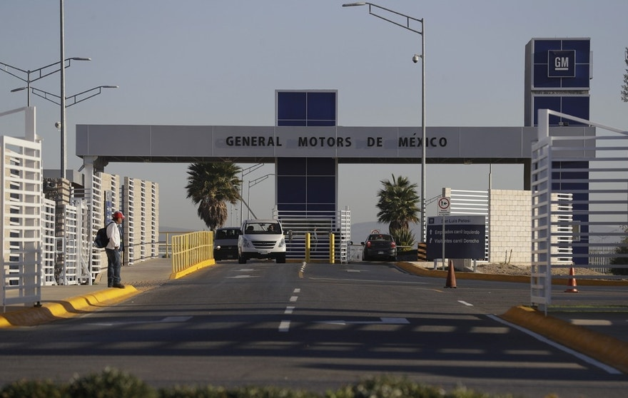 Cars exit the General Motors assembly plant in Villa de Reyes, outside San Luis Potosi, Mexico, Wednesday, Jan. 4, 2017, where the Aveo and Trax vehicles have been produced since 2008. President-elect Donald Trump sent tweets this week threatening to impose heavy tariffs on GM and Toyota cars produced in Mexico for the U.S. market.