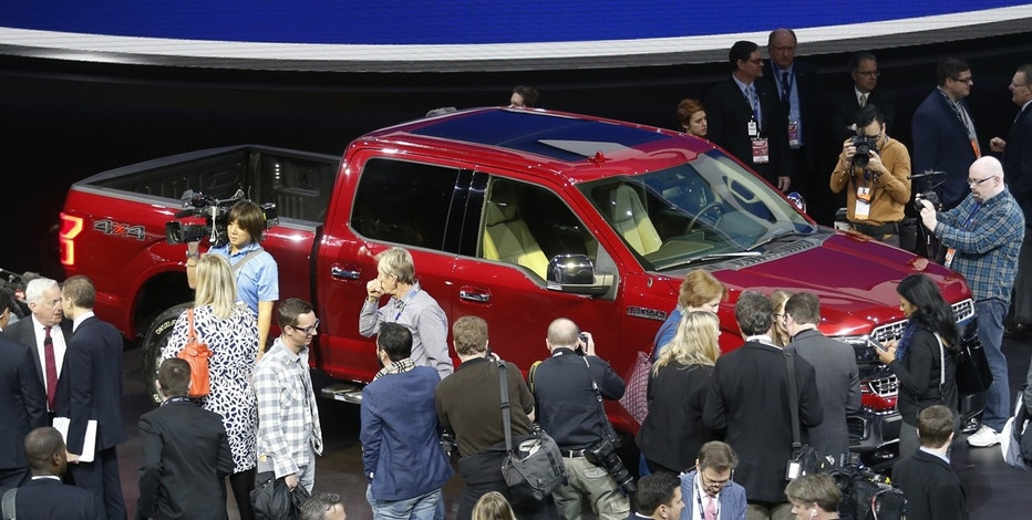 Members of the news media crowd around the 2018 Ford F150 pickup truck during the North American International Auto Show in Detroit, Michigan, U.S., January 9, 2017.