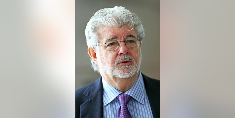 "FILE - In this Jan. 16, 2014 file photo, George Lucas speaks at an event in Singapore. ""Star Wars"" creator Lucas and his team announced Tuesday, Jan. 10, 2017, they have chosen Los Angeles over San Francisco as the home of the museum that will showcase his work. After what organizers called an extremely difficult decision, they announced Tuesday that the museum will be built in Exposition Park in Los Angeles, where it will sit alongside other more traditional museums. (AP Photo/Wong Maye-E, File)"