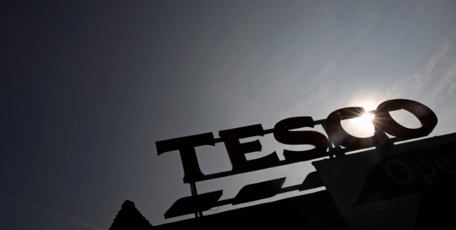 The signage of Tesco Extra is silhouetted against the sun in London, Britain, September 22, 2014.  REUTERS/Luke MacGregor/File Photo