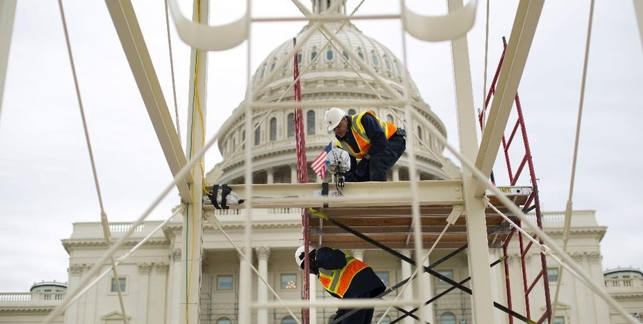 FILE - In this Dec. 8, 2016 file photo, construction continues on the Inaugural platform in preparation for the Inauguration and swearing-in ceremonies for President-elect Donald Trump, on the Capitol steps in Washington. Trump's Presidential Inaugural Committee has raised a record $90 million-plus in private donations, far more than President Barack Obama's two inaugural committees. They collected $55 million in 2009 and $43 million in 2013, and had some left over on the first go-round. But while Trump has raised more money for his inauguration than any president in history, he's aiming to do less with it.  (AP Photo/Pablo Martinez Monsivais, File)