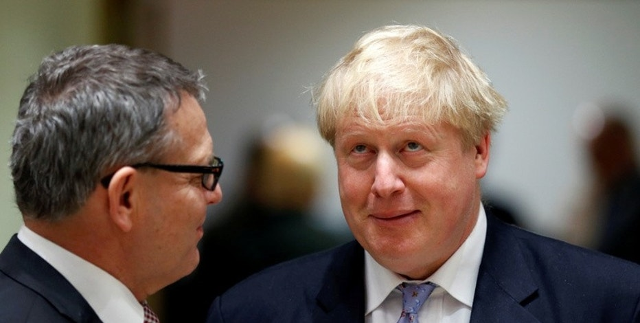 Czech Republic's Foreign Minister Lubomir Zaoralek (L) talks to Britain's Foreign Secretary Boris Johnson during a European Union foreign ministers meeting in Brussels, Belgium. REUTERS/Francois Lenoir